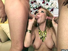 This sexy brunette MILF has a round jiggly ass and she loves to fuck it with her big black dildo. While having the anal pleasure, two guys come in and get their cocks sucked. Lady then gets fucked from behind and keeps sucking the other one. Let's see, if she gets facial with a few rounds of DP!