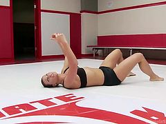 Looks like there'd be an upcoming team battle soon and no the tatami at the arena, a few lesbian wrestlers are warming up, and showing their acrobatic skills. All these ladies: brunettes or blondes, have noteworthy body fitness and they are ready to rumble for their ultimate victory, to win the strap-on trophy.