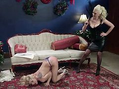 These two beautiful blondes enjoy having lots of lesbian love making, however what excites the most, is a dominating sex. Now, one blonde in the role of mistress is spanking the other blonde's ass and toying with her naked body. She plays with her nice tits and sucks pink nipples, with fingering twat.