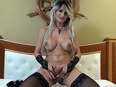 Busty transsexual milf has amazing pair of big titties, round jiggly ass and hard big dick. Wearing a sexy black lingerie, blonde ladyboy displays her delicious body and teases with her fat cock. With hard nipples and aroused cock, tranny starts jerking her dick and takes off her loads with pleasure.