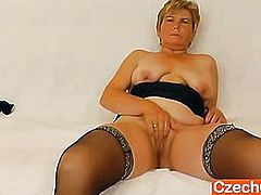 Orgastic wife playing with a rubber cock