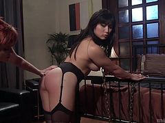 Lily shows no mercy to her sex slave, especially when it is an exotic Asian woman, who is just too hot. She keeps Mia chained and tied up all over her body. Lily even makes to eat off the floor, then bends her round ass over and whips it, until Mia screams in pain and pleasure. The stunning redhead fucks the Asian whore hard and long.