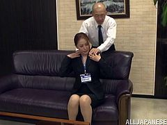 Beautiful Asian dame unpins her top showcasing her natural tits before giving her guy blowjob and getting smashed hardcore in the office