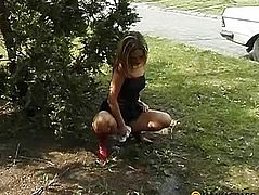 Sitting behind the bushes pissing baby