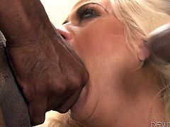 Holly has developed a lusty passion for black cocks. On the other side, the attraction is also very strong. Whose cock wouldn't get hard in front of such an amazing beauty? The blonde milf with fascinating tits lets her body explored by all four men... See her sucking cock and spreading her legs widely.