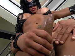 This dirty bitch is wearing a mask and a skimpy bikini. That is all she has on. The dirty girl looks sweet with her tanlines and massive cock. She wants me to suck her, so she shoves her hard penis down my throat and makes me give her a blowjob. She sucks me off, too.