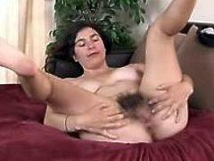 Hairy Rahia plays with her pussy
