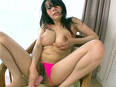 Solo Asian babe Kyouko Maki spreads pussy curtains and fucks her slit with sex toy