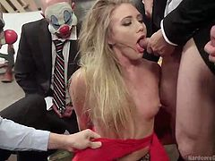 If you're looking for a hot babe, meet Aj Applegate, a versed bitch which can drive mad any man from the room. Guys wearing carnival masks and suits persuade the blonde-haired slut into sucking their horny cocks, after having torn her red dress. Click to see the hardcore scenes!