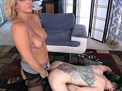Lonely guy submits to strapon ass fucking from a dominant milf