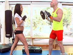 A hot brunette babe wants to keep fit and regularly works out at the gym. But box isn't the only reason for her presence there... The attractive lady succeeds in seducing her personal trainer. Blessed with fascinating big tits, this bitch easily turns on the bald guy. See her sucking cock passionately!