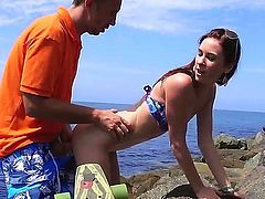 Tysen Rich is not afraid to do it in the public. She went down on this guy right by the sea, while lying on the rocks enjoying the hot weather.