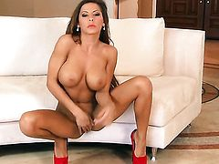 Madison Ivy with huge knockers and shaved cunt inserts toy in her bush