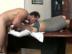 Leggy secretary gives good blowjob to horny boss right on his table