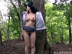 Ravishing Japanese solo model poses nude in the forest