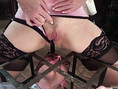 With his hands in chains and closed in a kinky cage, this horny man has no way than fulfilling every wish his mistress may have. The blonde versed milf is dressed up sexy and her lingerie is a huge turn on. Watch her ordering the guy to eat her pussy, or torturing his cock.