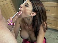 Buxom red haired beauty gives solid BJ to her cute BF at kitchen