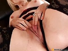 Woman caresses pussy sitting on the couch
