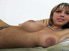 Blonde Mellie with big butt and shaved muff fucks herself like mad in solo scene