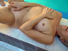 Frightful blonde mature slut Jitka fucks with toy in the swimming pool