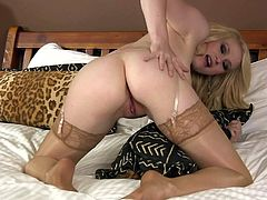 Big breasted blondie Tegan Jane in sheer stockings plays with her hairless meaty pink pussy in the middle of the bed for your viewing entertainment. She shoves her fingers into her hole eagerly!