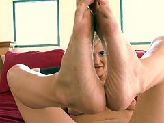 Totally naked blonde Amanda Tate with natural boobs shows off her bare feet and plays with her hairless pink snatch with legs wide open on the bed. She keep her legs spread apart for your viewing pleasure.