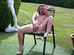 This solo girl is about to finger her tight and dripping wet twat outdoors. She is sitting on a garden chair and she fingers herself till she gets an earth trembling orgasm
