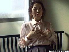 Ugly Japanese MILF plays with her tits and rubs her clit through panties