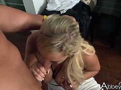 Stunning bombshell Abbey Brooks guzzles hard dick standing on knees