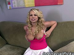Pretty young blonde pornstar in miniskirt shows her big tits
