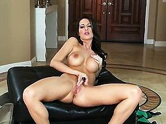 Kortney Kane with massive tits and trimmed beaver is totally naked and plays with her love box non-stop