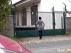 Shy looking brunette bitch made piss near green gates