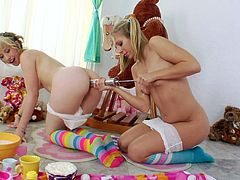 Pigtailed lesbians in socks enjoy toying their assholes in a messy scene