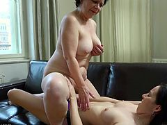 Fresh girlie wears strapon and fucks wet meaty old cunt of Karla