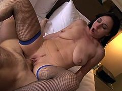 Horny black haired MILF in blue fishnets rides big sausage in reverse cowgirl pose
