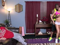 Romi is a sexy whore with boobs to die for and she is not satisfied with what she gets from her husband. Her husband is a lazy ass, who lies around on the sofa all day and refuses to fuck her. That's why she brought home Rob, who is always willing to please her. Watch this hunk give her some lessons in humping, as he gives her some tips on working out.