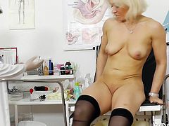 She heads to the doctor, to figure out what is wrong with her old cunt. She must have been getting fucked too hard. With her legs in stirrups, the doctor examines her old pussy. She has her tits played with and a huge dildo shoved into her warm hole.