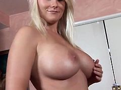 Sexy blond haired beauty flashes boobies and gives nice blowjob