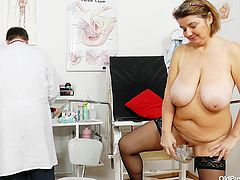 A chubby woman wearing kinky stockings lays in front of the gynecologist, legs widely opened, to offer a great perspective of her naughty pussy, from a crystal clear closeup. The mature Czech lady seems interested in doc's opinion, doing as told at the detailed medical exam. Click to watch and enjoy!