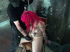 Slutty Proxy can't scream for help, as she wears a kinky ball gag and has her hands tied strongly with ropes. The redhead naked babe is punished severely by a dominant executor, who keeps her as a sexual slave, to fulfill his own sick desires. See the bonded bitch's pussy aroused...