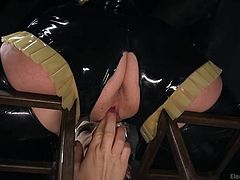 Freya must have been naughty, because right now she is in a cage, doing exactly what Mona tells her to do. The blonde mistress has her caged brunette slave licking her pussy, just as she is told. She gets a few zaps from Mona with a wand, encouraging her to lick the right spot at the right speed.