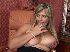 Are you fond of mature ladies? If so, dare to watch a versed milf playing dirty in her intimacy. She generously shows off her big breasts and lusty cunt in front of the camera, while playing with a dildo, which she sensually sucks and then inserts it in her pussy. Don't miss the detailed scene!