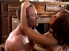Beautifully dressed well-endowed woman Halie James gives blow job to totally naked guy on her knees in the middle of the room before it comes to cock riding. Watch Halie James get down and dirty!