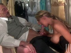 Busty Charisma Cappelli in tempting black lingerie is a breathtaker. She gets down on her knees and gives headjob to Randy Spears with her perfect big jugs out. Hot woman!