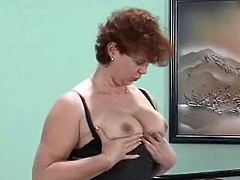 Barbara was just getting ready for daycouch but undressing her outwear off and seeing her sexy black stockings really Made her horny. she then Starts Massaging her juicy jugs and finger fucking her bushy box to orgasm.