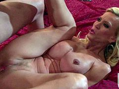Big titted mature blonde Amber Lynn in high heels shows her neatly trimmed experienced pussy to hot guy. He sticks his fingers in her hoe and then bangs her hard with his stiff dick.