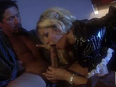 Bare ass milf blonde Jessica Drake in short black dress plays with her tight holes and then gets her mouth filled with rock hard dick. Kinky woman gives nice blowjob in the semi-dark.
