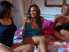 Krissy Lynn, Zoe Britton and Kirsten Price bare their assets and play with each other on a king size bed. They do their best to make each other happy in lesbian threesome action.