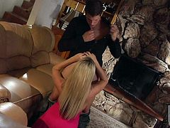 Good looking MILF Carolyn Reese with long blond hair and nice tits gives headjob in the middle of the room on her knees and then gets her pussy boned. She gets her twat drilled good in hardcore fuck session.