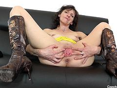 If you're into slutty cougars, this horny Czech lady is ready to show her shaved cunt! See the mature bitch undressing and revealing her tits. She stretches her cunt in front of the camera and then, uses a kinky dildo. Enjoy the detailed solo scene!